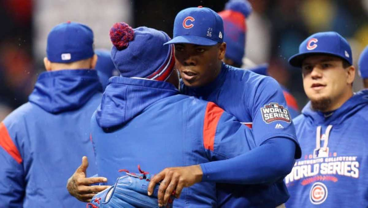 Chapman hugging Cubs Manager Joe Madden during the World Series in 2016.