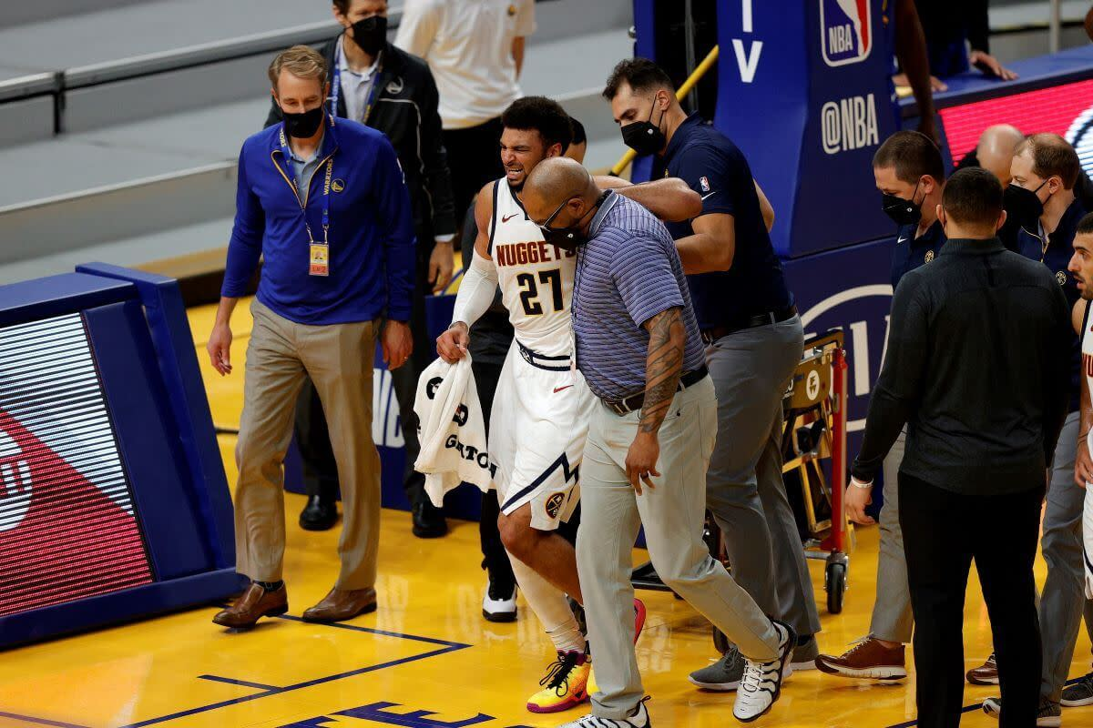 Nuggets Star PG Jamal Murray tears his ACL late game against the Warriors.