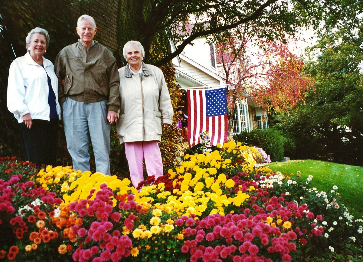 My mother, uncle and aunt with mum plants in foreground