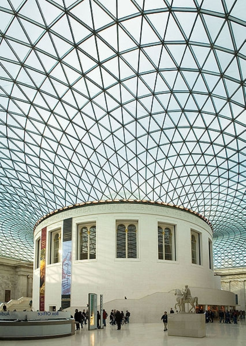 The Great Court of the British Museum, with the tessellated roof designed by Foster and Partners arching around the original, circular, Reading Room of the British Library.