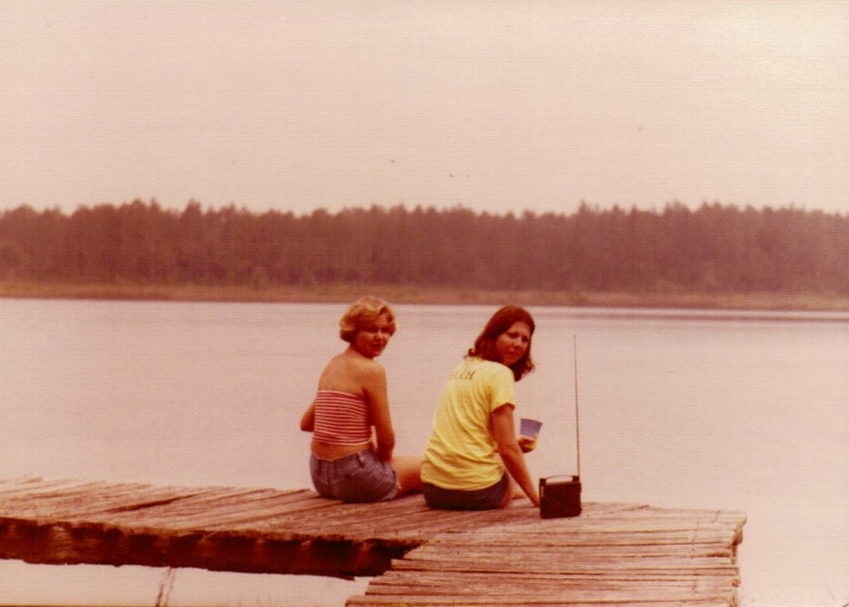 They sat close together on the rickety dock.
