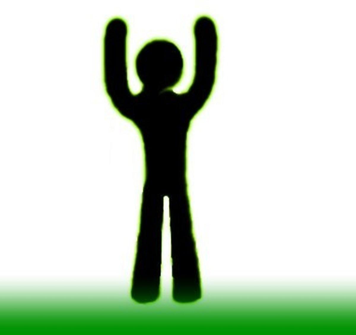Raising Both Hands–Goal/Success