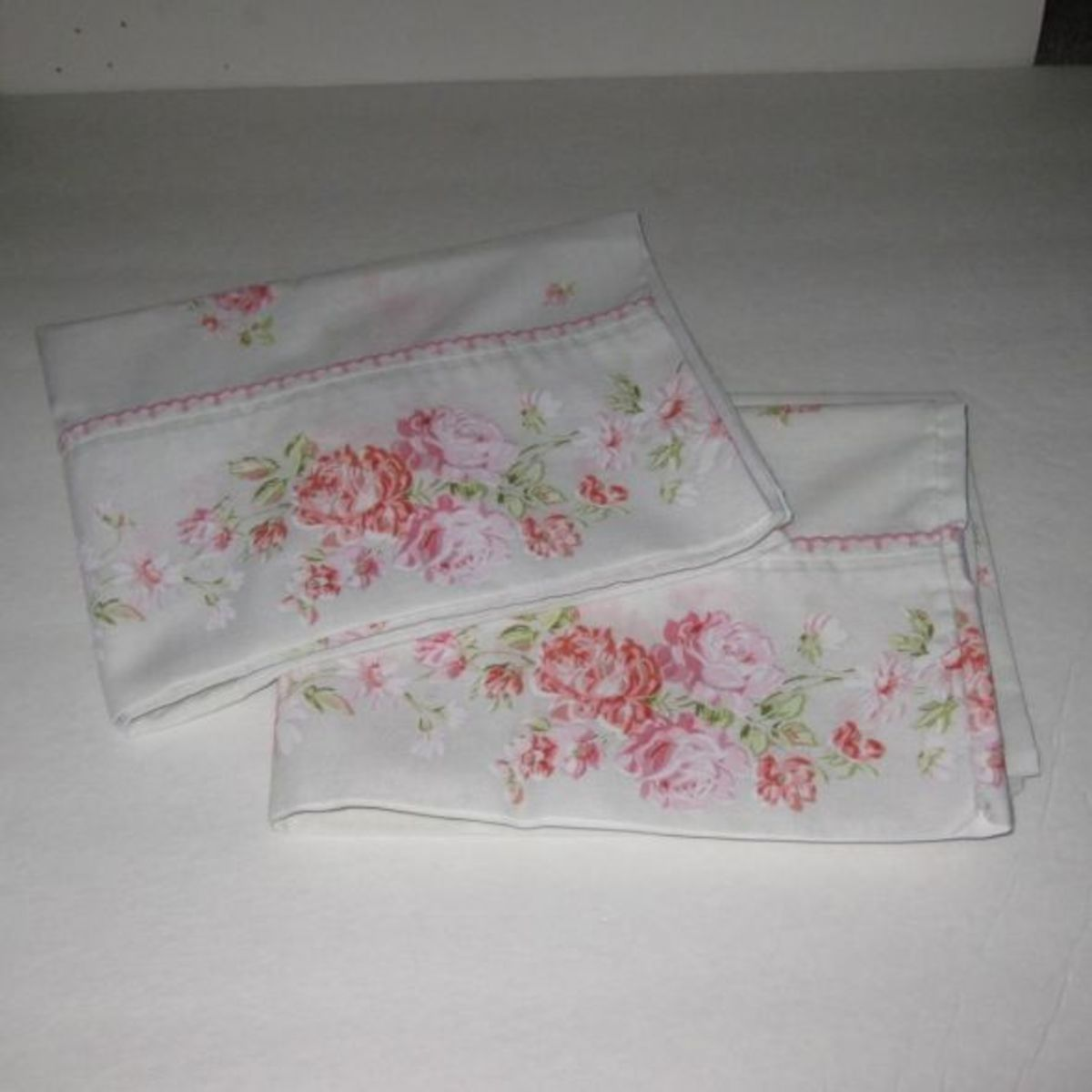 Cabbage roses on vintage pillowcases.