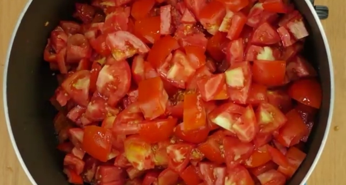 Wash and cut tomatoes into cubes