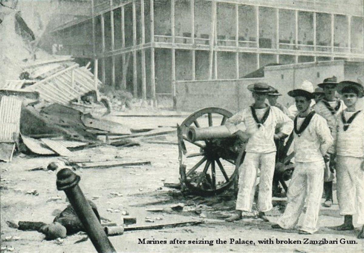 British sailors alongside a crippled Zanzibari cannon.