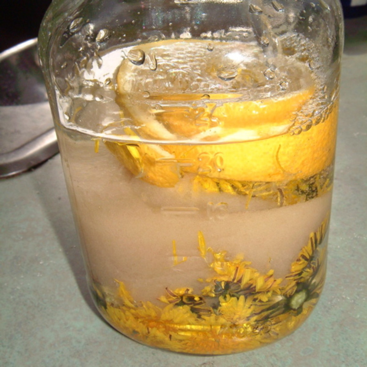 Adding sugar, lemon and vodka
