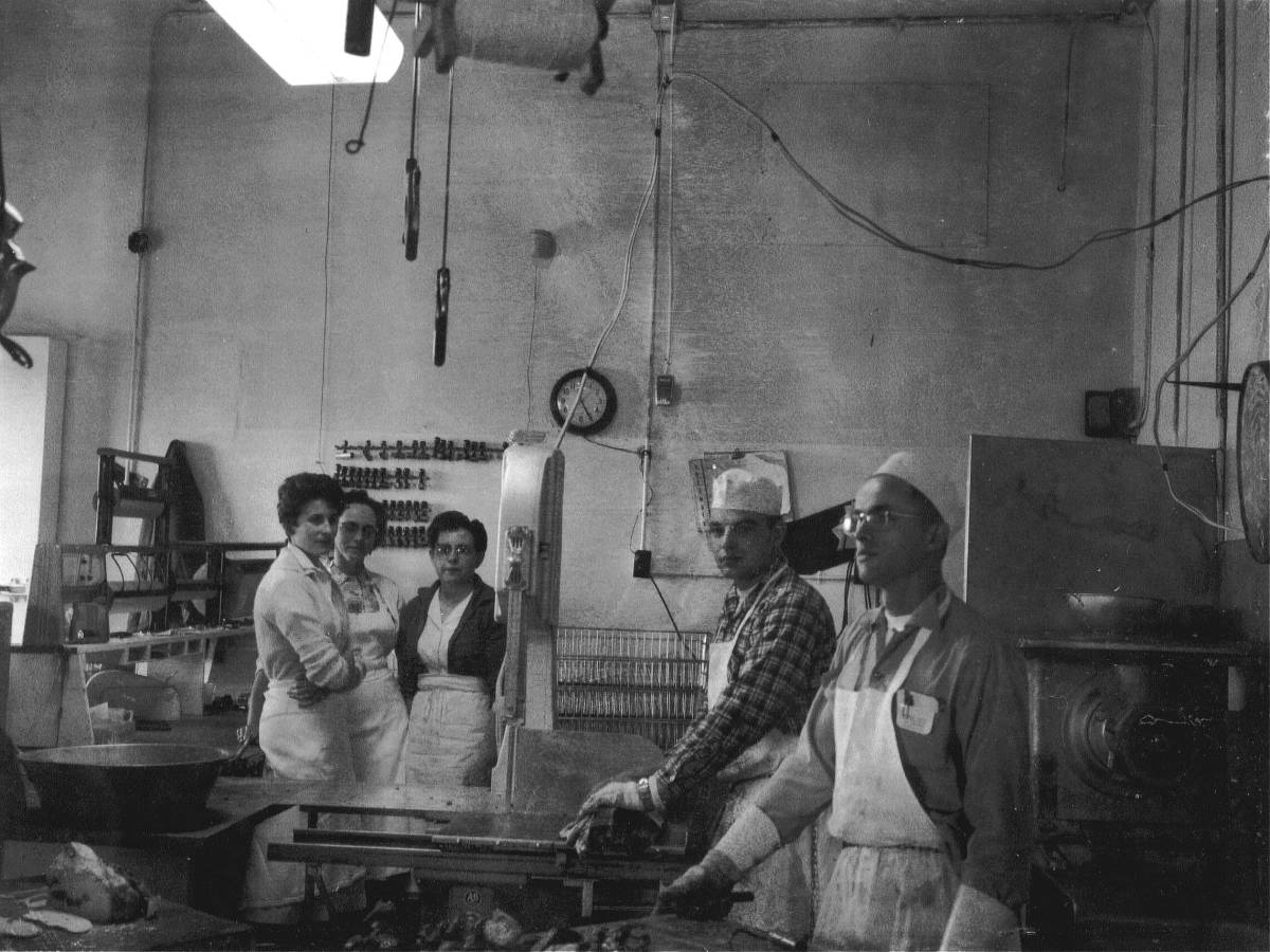 L to R: Mom, an employee, my Grandmother, Dad, another employee. The meat grinder is farthest to the right.