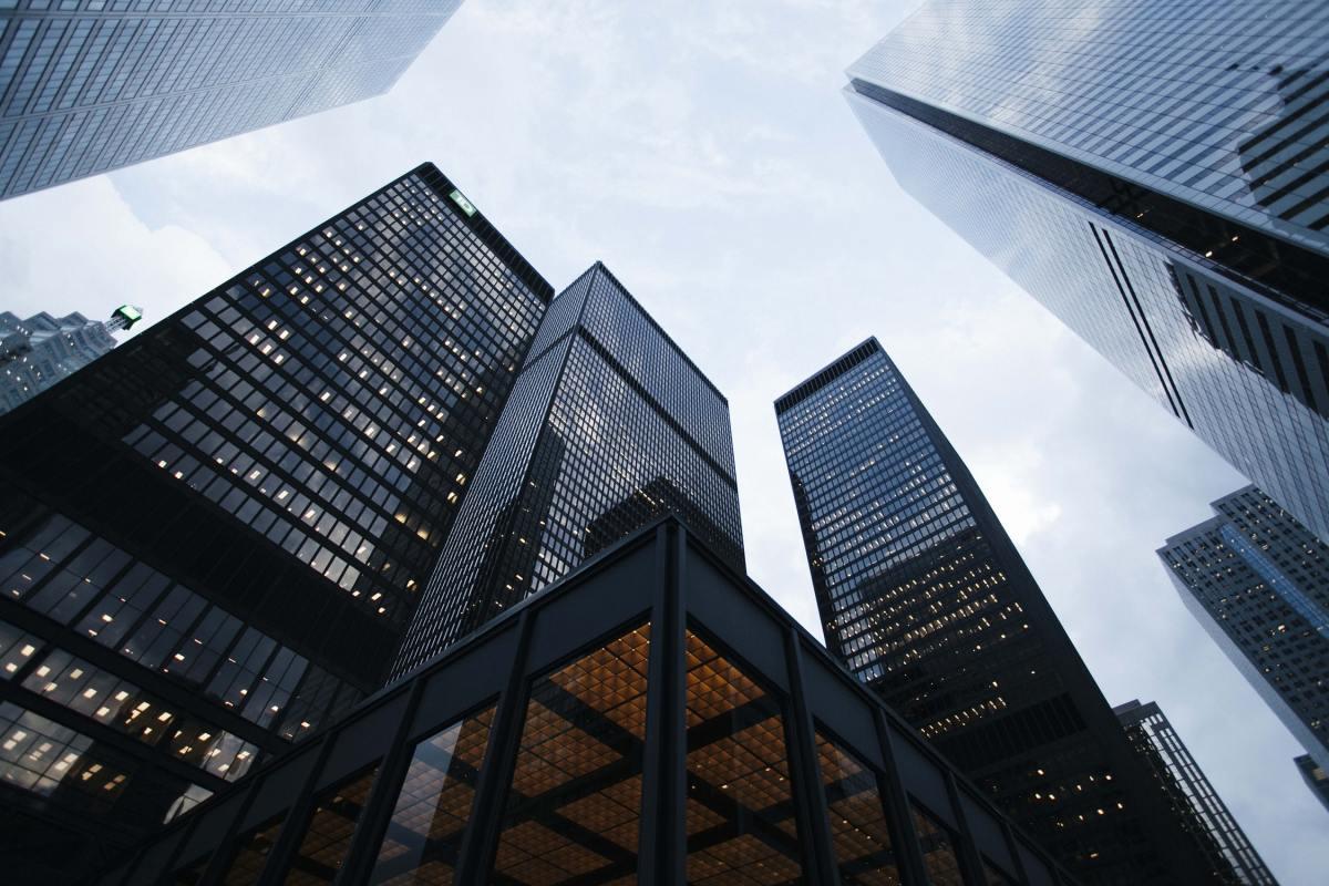 Corporate high rise buildings. Photo by Sean Pollock via Unsplash.