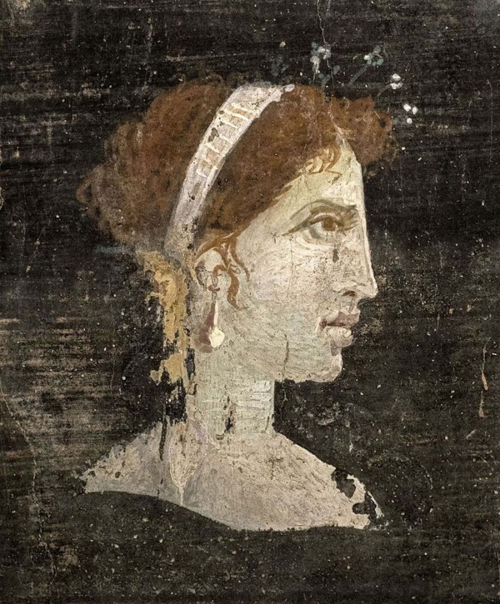 Most likely a posthumous painted portrait of Cleopatra VII of Ptolemaic Egypt with red hair and her distinct facial features, wearing a royal diadem and pearl-studded hairpins, from Roman Herculaneum, Italy, 1st century AD