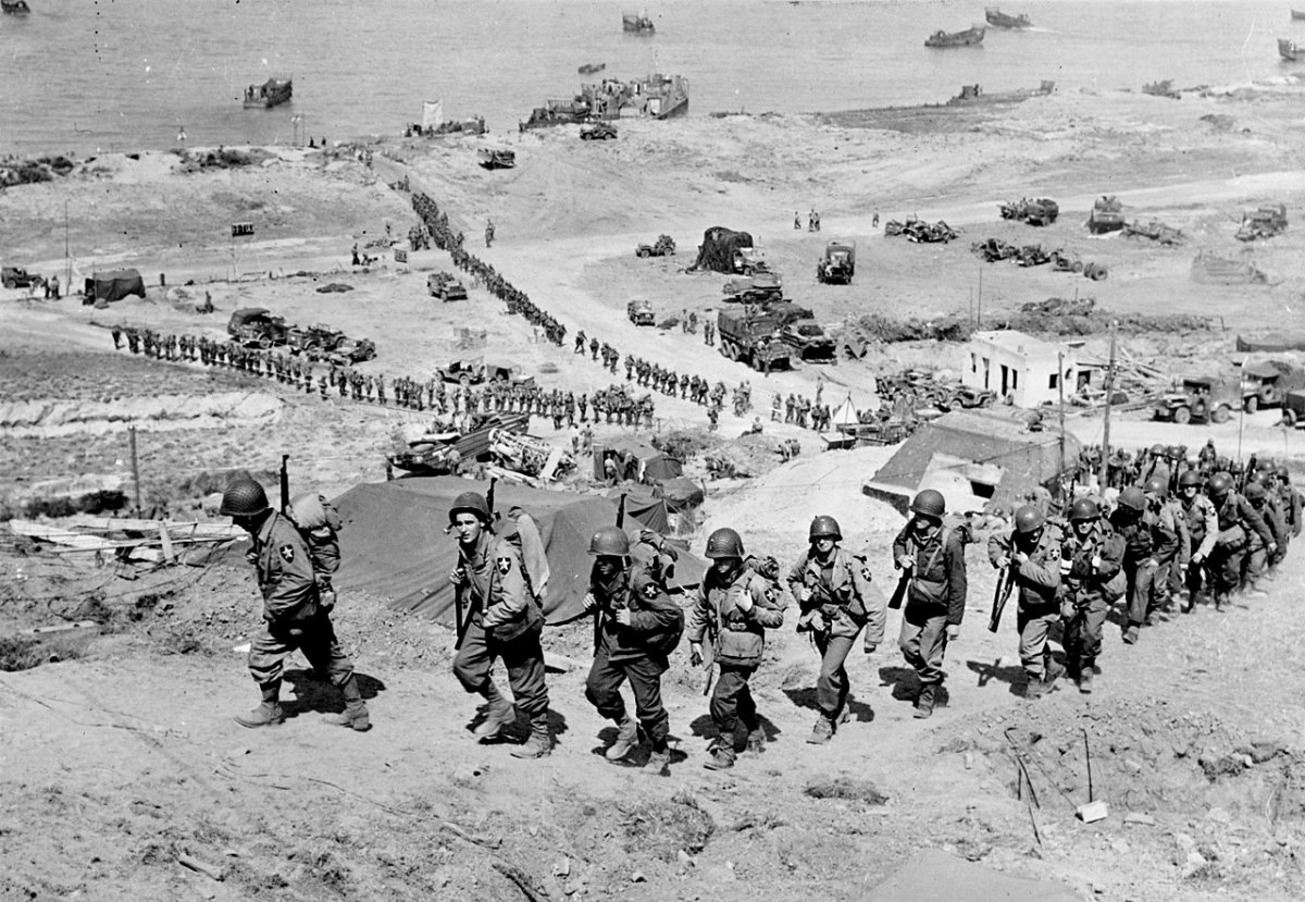 Troops 2nd Infantry Division and their equipment going up the bluff via the E-1 draw on D+1, June 7, 1944.