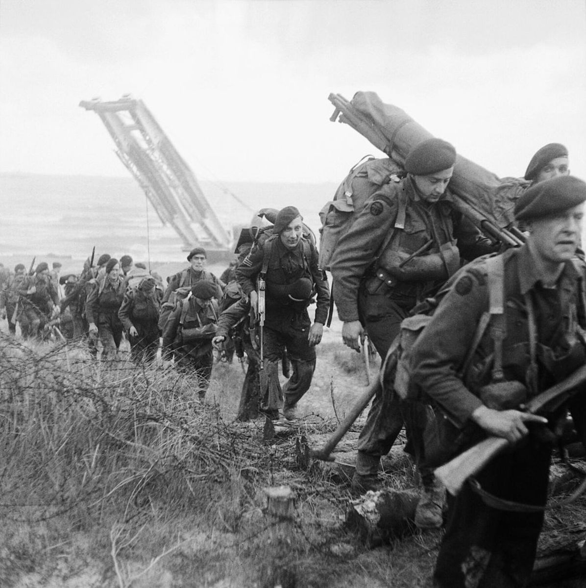 Royal Marine Commandos attached to 3rd Infantry Division move inland from Sword Beach, in the early morning of June 6,1944.
