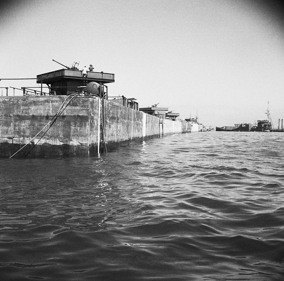 Mulberry in place at Arromanches, with anti-aircraft guns installed June 12, 1944.