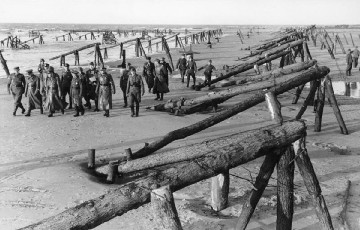 What American troops had to deal with on D-Day. Logs driven into the sand pointing seaward and also capped with mines.
