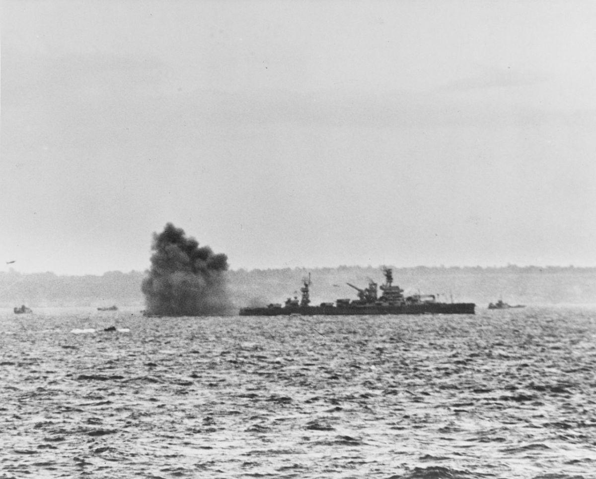 The American Battleship Arkansas engaging German shore batteries off Omaha beach June 6,1944.