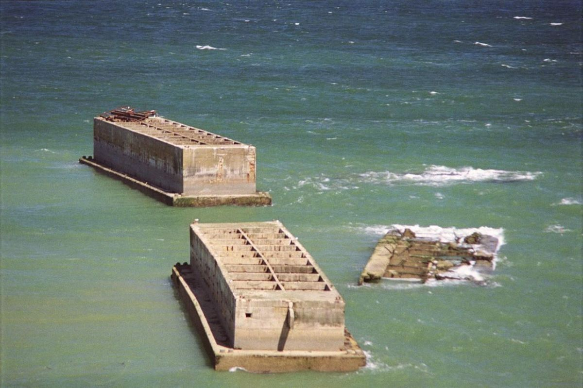 Mulberry harbors today in the surf off Normandy massive concrete monuments to the battle for Normandy D-D June 6, 1944.