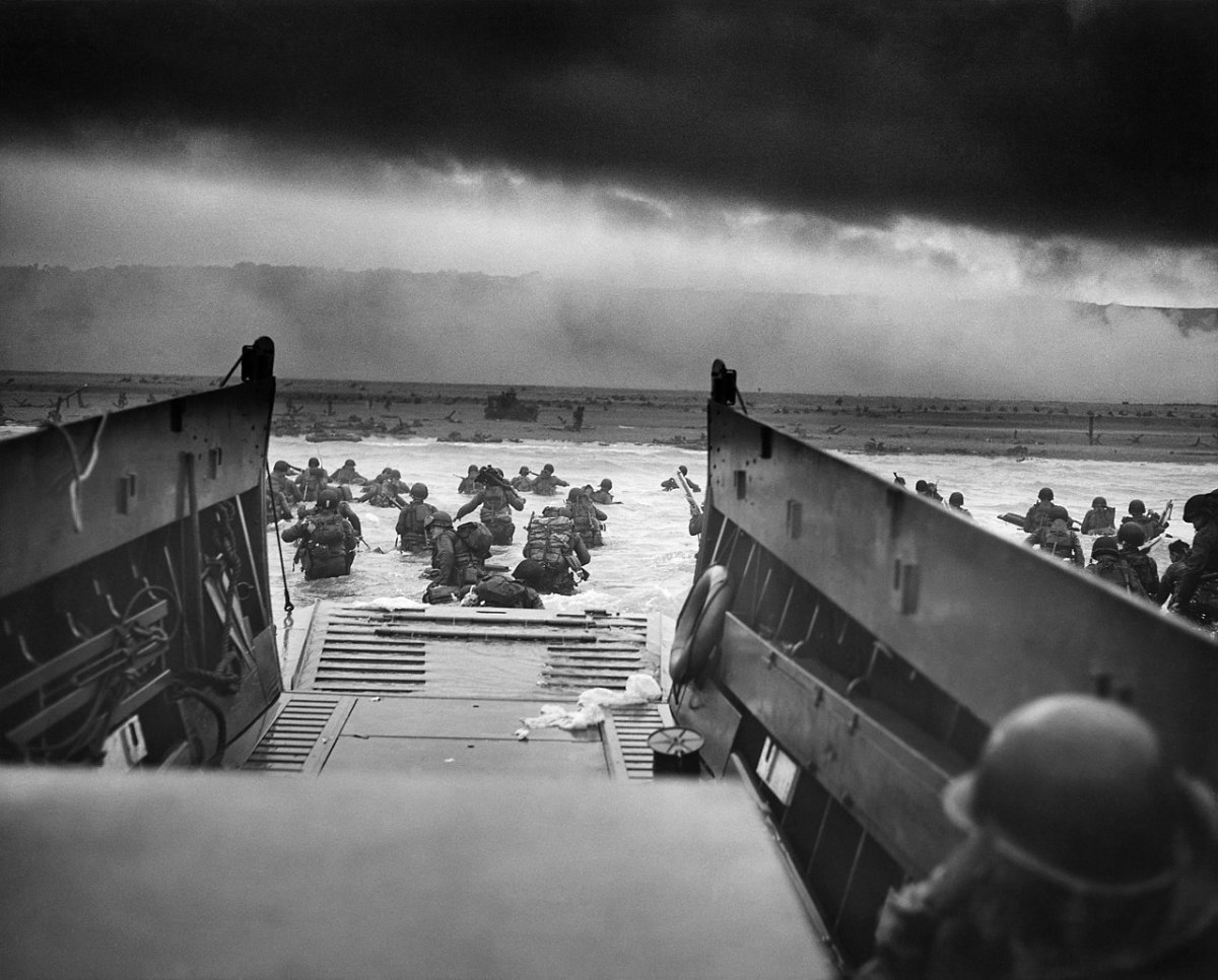 """Through the fog of war American troops of the 1st Infantry Division wade ashore onto the killing field known as """"Omaha Beach"""" on D-Day June 6,1944."""