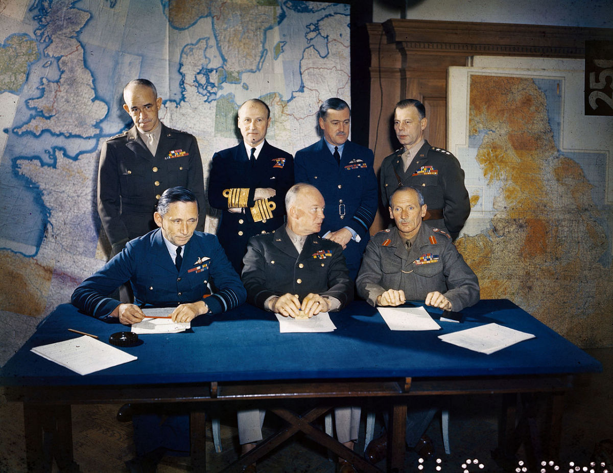 Months before D-Day Eisenhower meets with his generals to plan out the invasion of Normandy, France. Eisenhower is seated in the middle of the front row.