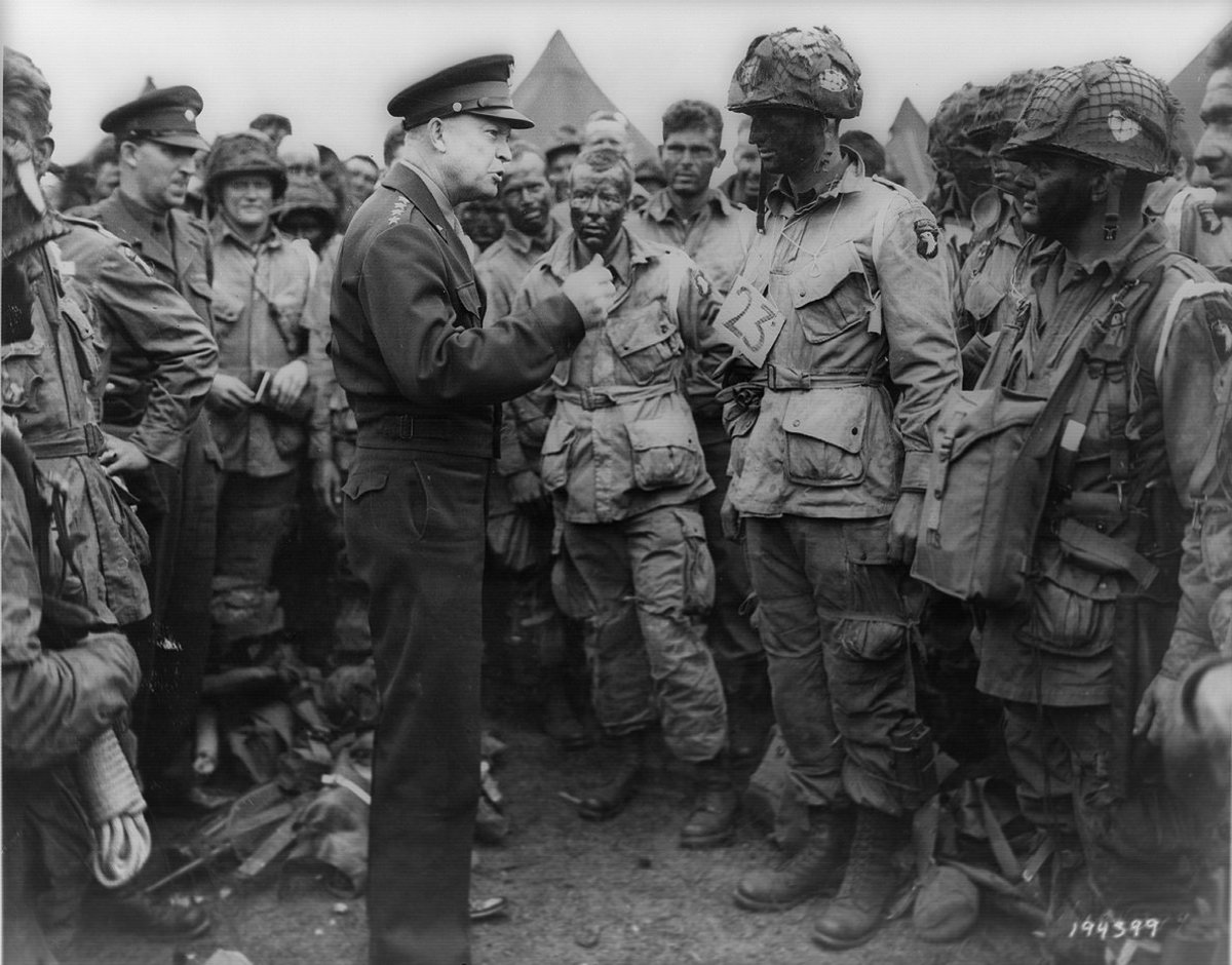 General Dwight D. Eisenhower speaking with First lieutenant Wallace C. Strobel and men of Company E, 2nd Battalion, 502nd Parachute Infantry Regiment of the 101st Airborne Division  on June 5, 1944. The would be the first to drop onto Normandy.