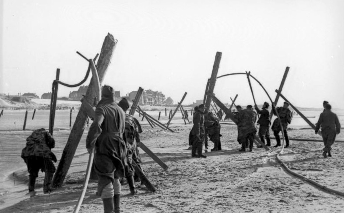 German troops building beach obstacles along the beach.