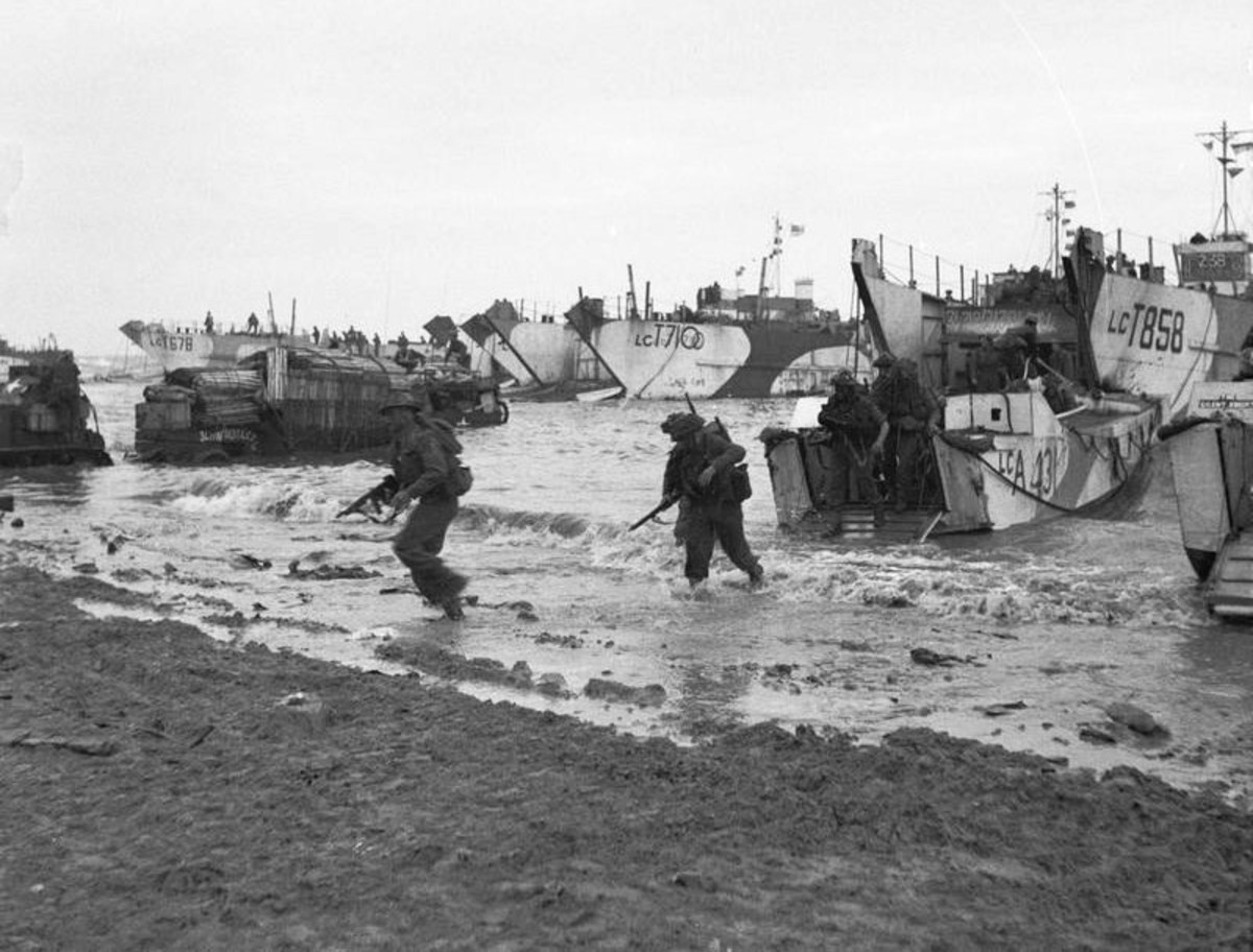 British troops come ashore at Jig Green sector, Gold Beach under light enemy fire.