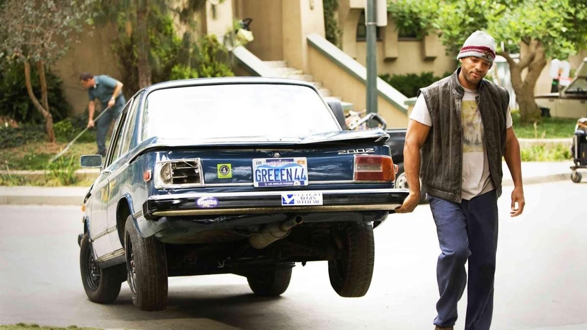 Hancock drags Ray's car.