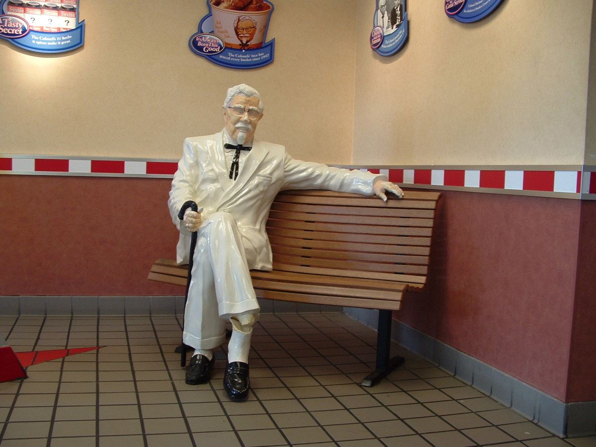 Colonel Sanders chills on the bench.