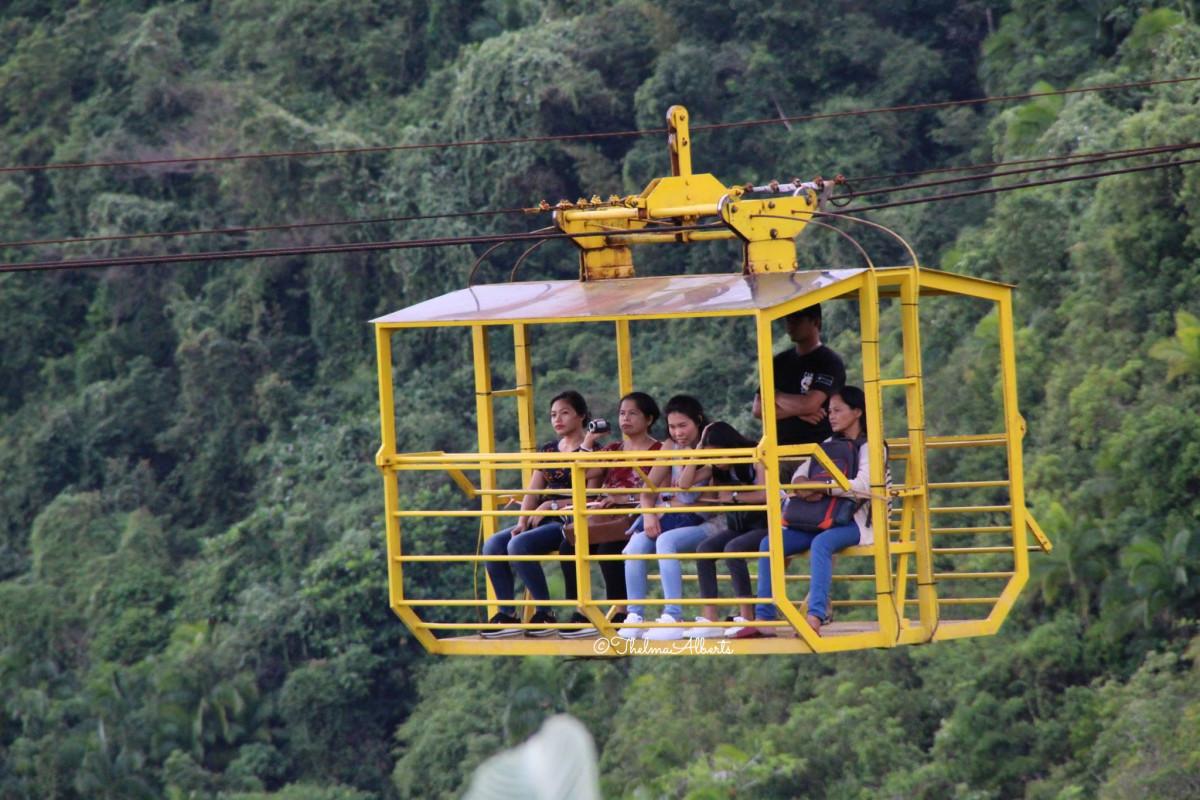 Riding the cable car at the Loboc Eco -Tourism Adventure Park.