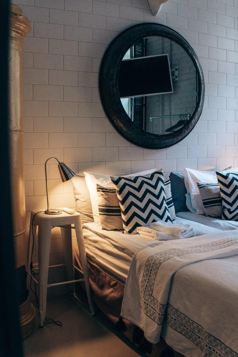 Black and White pattern pillows to contrast the netural bedding