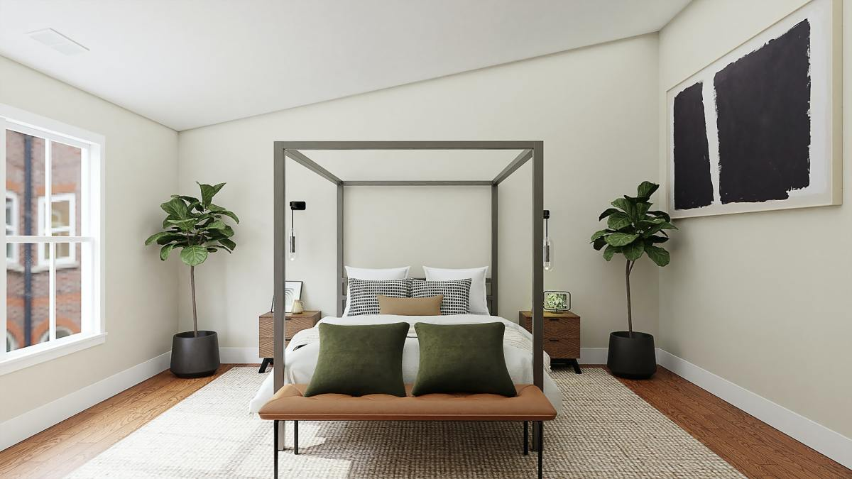 Notice the olive green, sandy and black and white pillows, along with vibrant green plants, tied together with neutral bedding and a similar neutral colored, TEXTURED rug