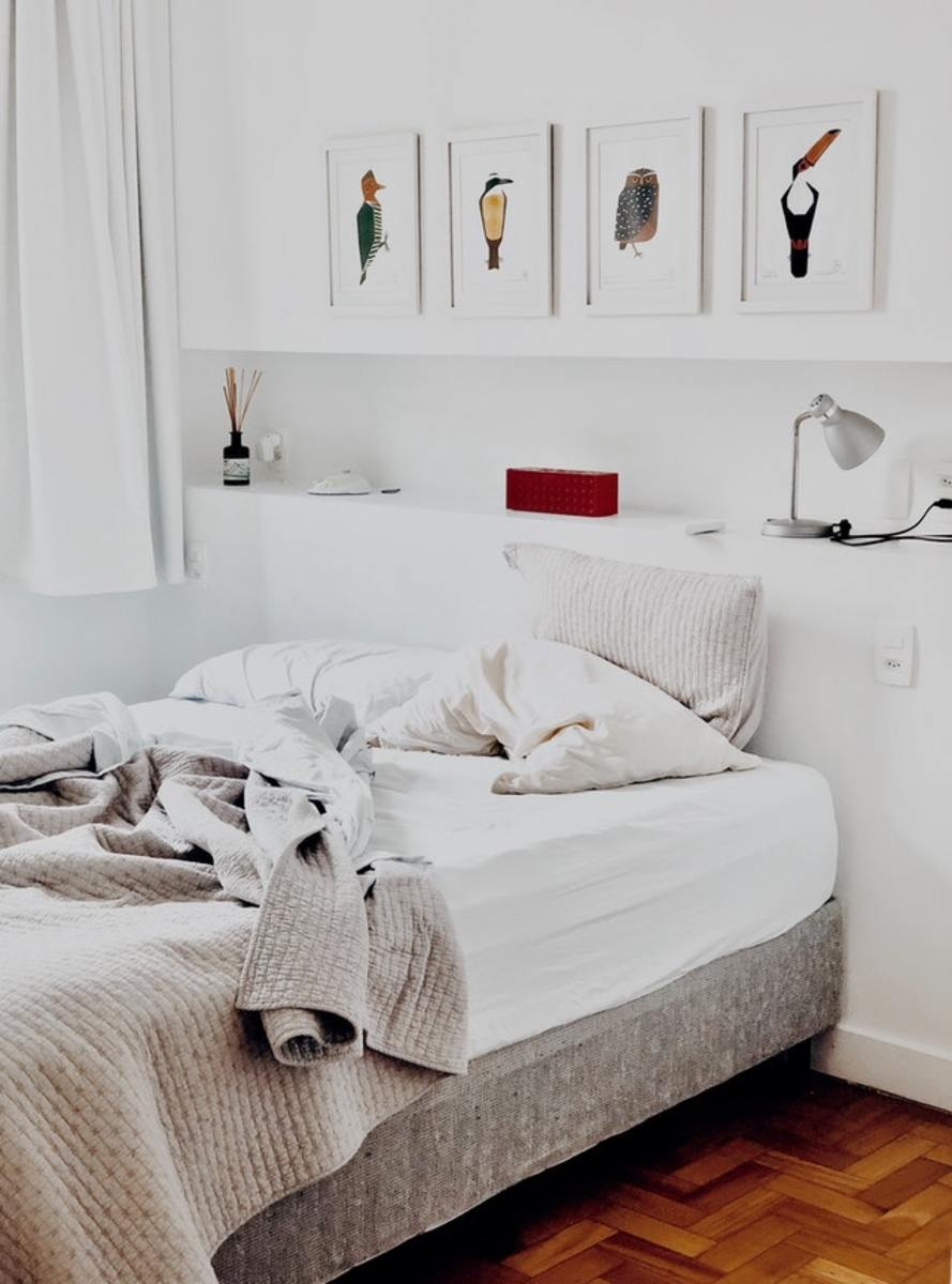 Notice the cream throw type blanket complimenting the white bed