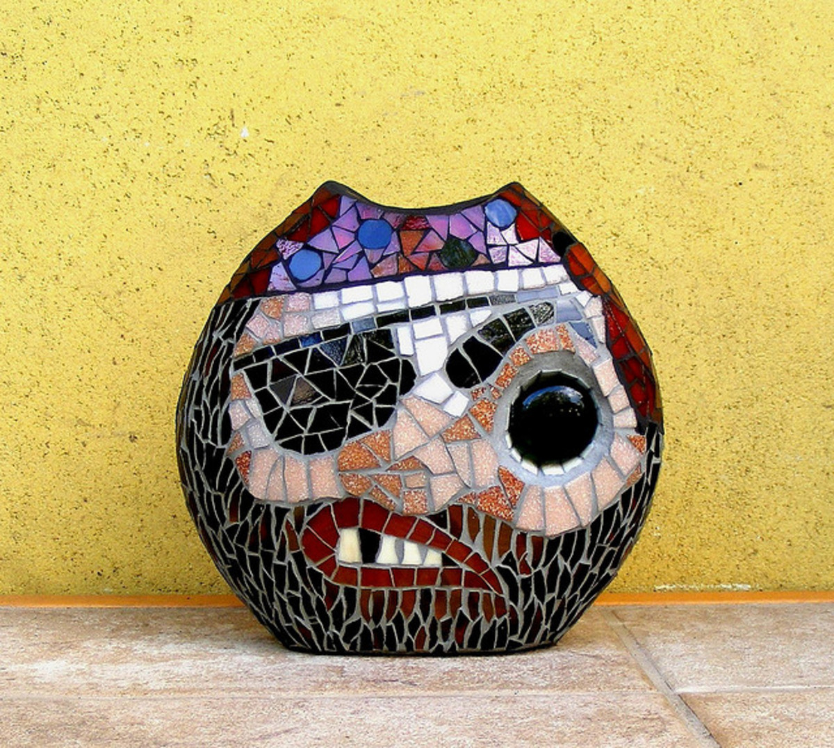 Learn the art of mosaic making and you can make vases as cool as this one!