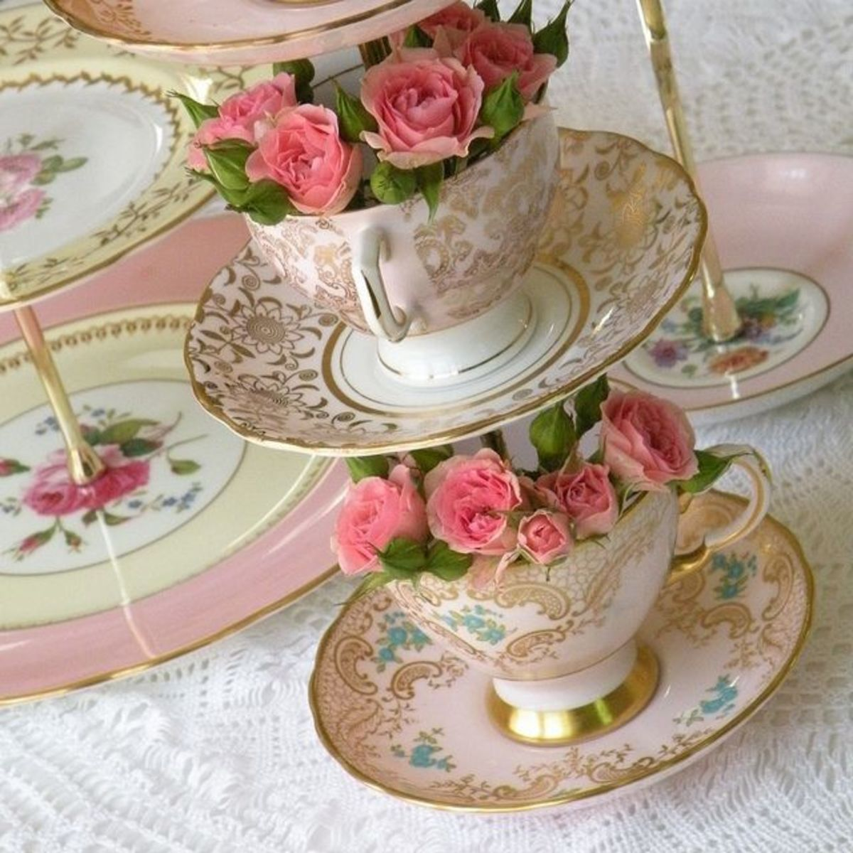 This lovely centrepiece has been made by drilling through 3 teacups and saucers and then stacking them on a metal rod.