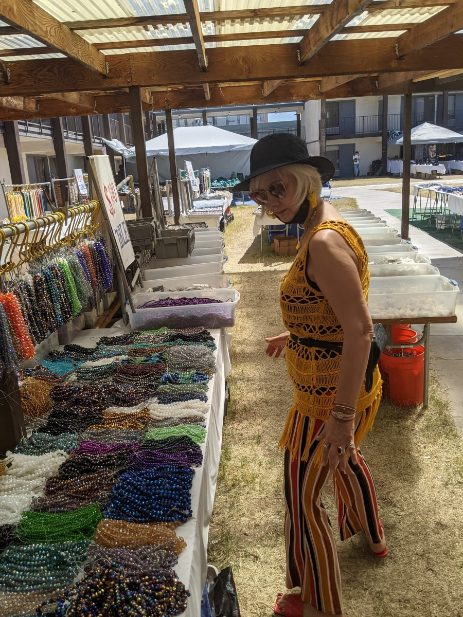 My wife looking through piles of beads seeking ones to make necklaces with