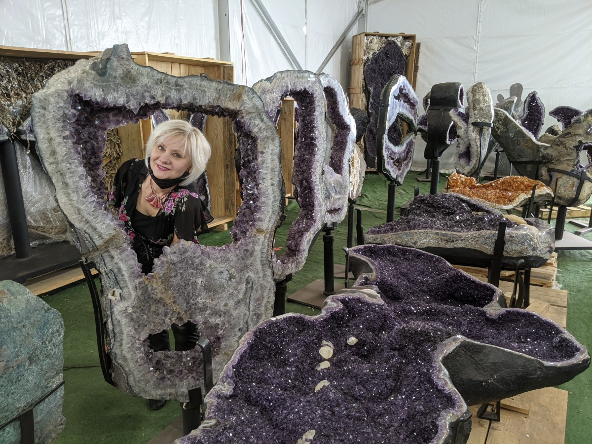 My wife posing in the midst of large geodes at the Tucson Gem and Mineral Show