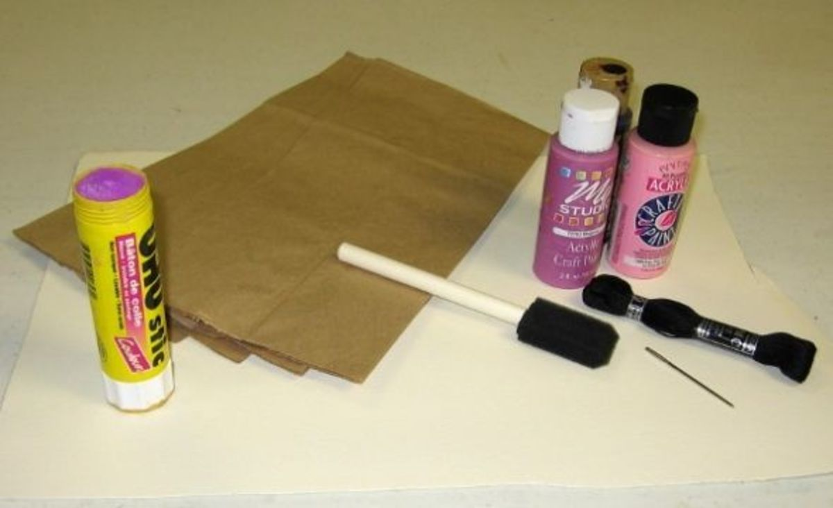 Supplies for making a paper bag book.