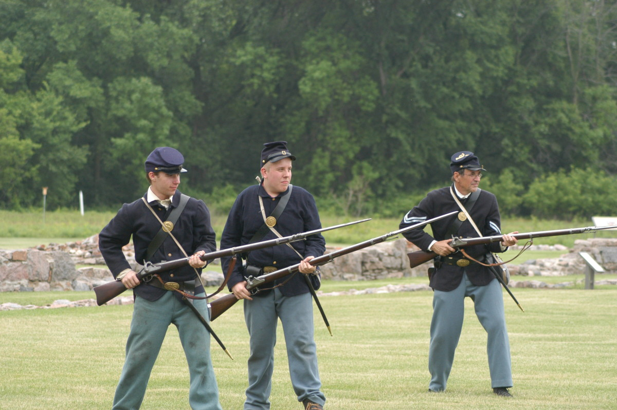 Living Historians come to a Middle Guard position in Bayonet Drill