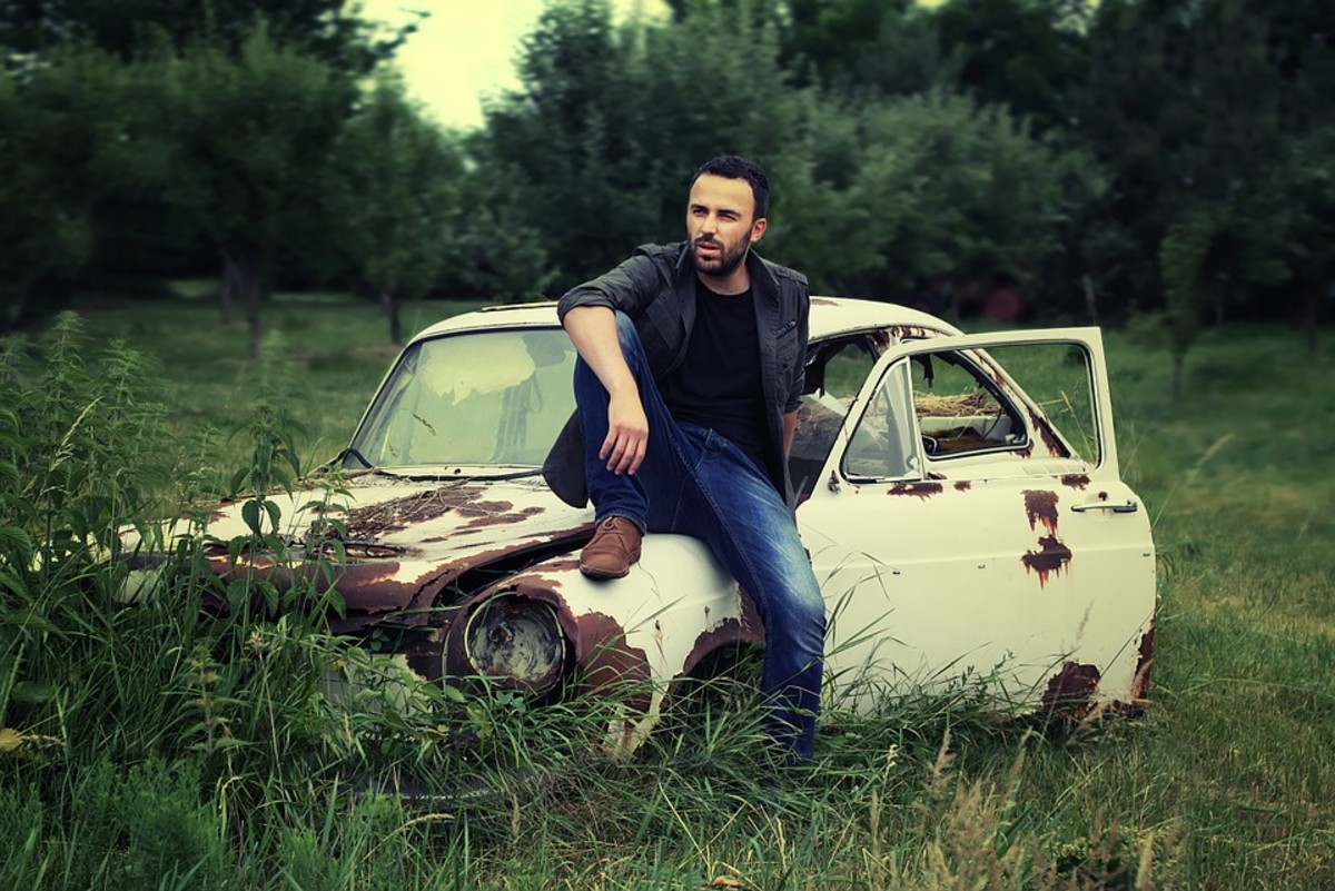 This male model loves to sit around and do nothing on old rusted cars.