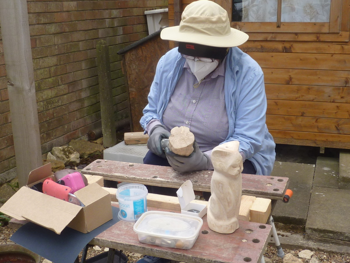 Here I am, kitted out in my work clothes, getting to grips with some wooden cats.