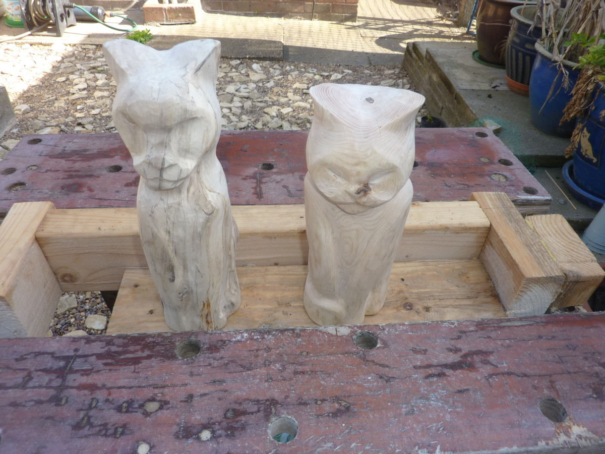 Two log cats sitting in the jig.