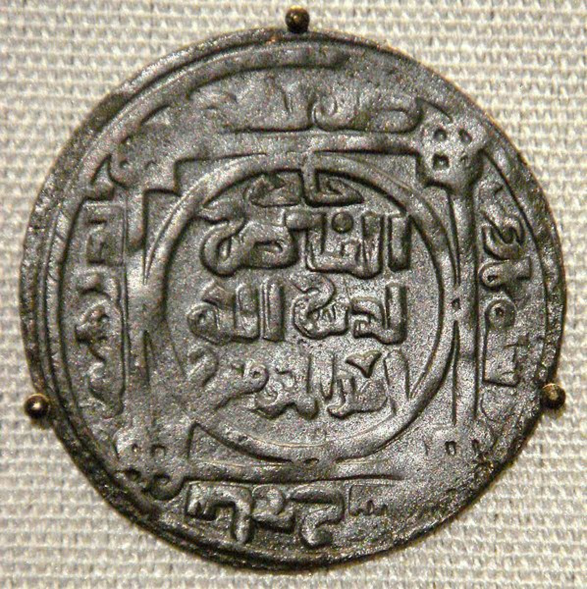 Mongol ~ Great Khan's coin ~ minted at Balk Afghanistan ~ AH 618 ~ AD 1221. 'I, the copyright holder of this work, release this work into the public domain.' ~See:http://en.wikipedia.org/wiki/File:Mongol_Great_Khans_coin_minted_at_Balk_Afghanistan_AH