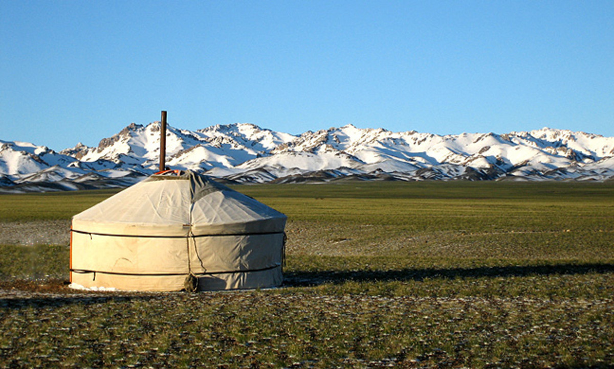 'Yurt with the en:Gurvansaikhan Mountains behind, part of en:Gobi Gurvansaikhan National Park'. See: http://en.wikipedia.org/wiki/File:Gurvger.jpg