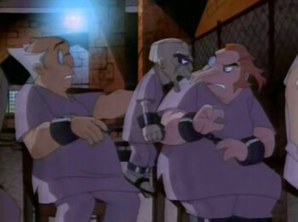 The Ventriloquist in therapy with Joker and Penguin in Arkham Asylum.
