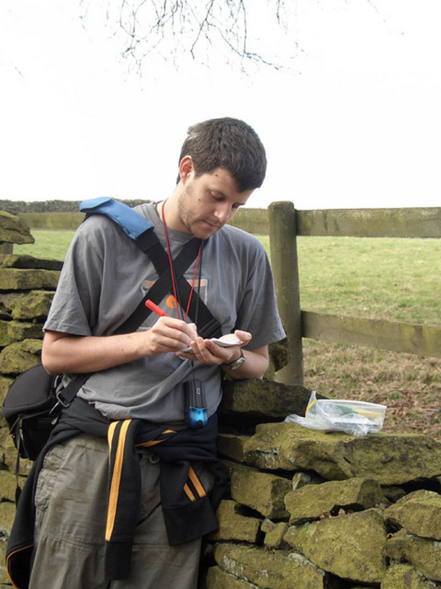 Geocacher Signing a Log Book