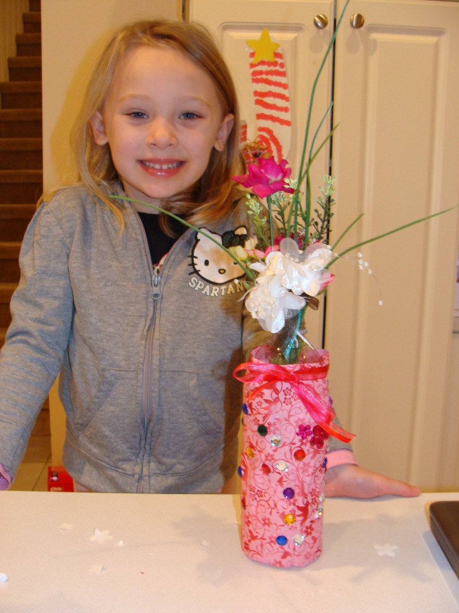 Grace is excited to give her vase to her teacher!