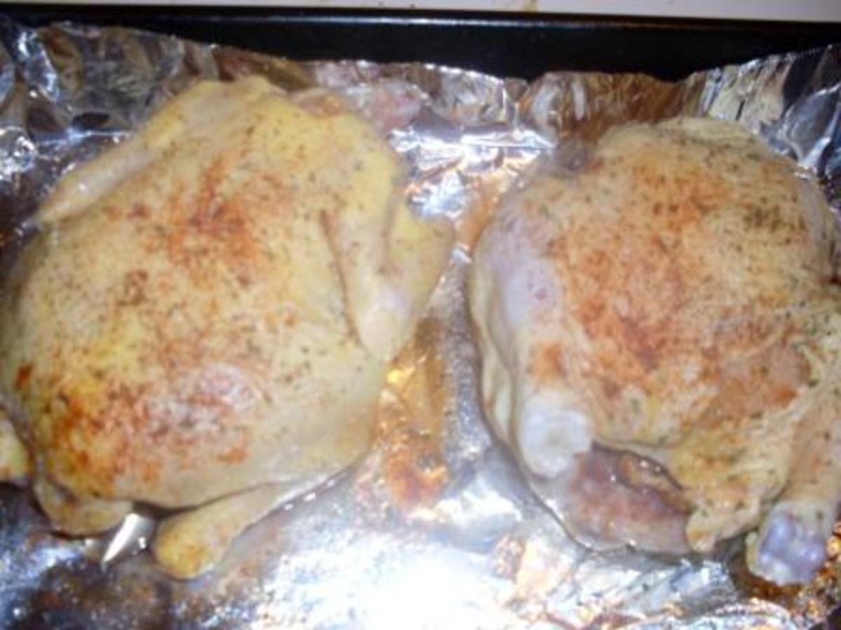 raw cornish hens, prepped and seasoned for broiling.