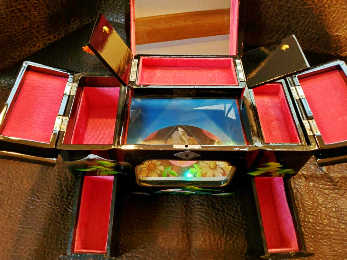 There are five compartments to hide your treasures in this lovely jewelry box. The glass viewing sections for the dance floor and dancer, are both on the top and front of the jewelry box.