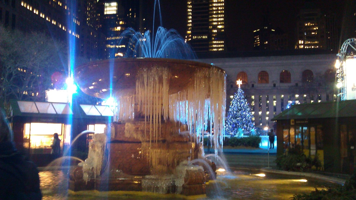 Icicles dripping from the fountain in a park in Winter.