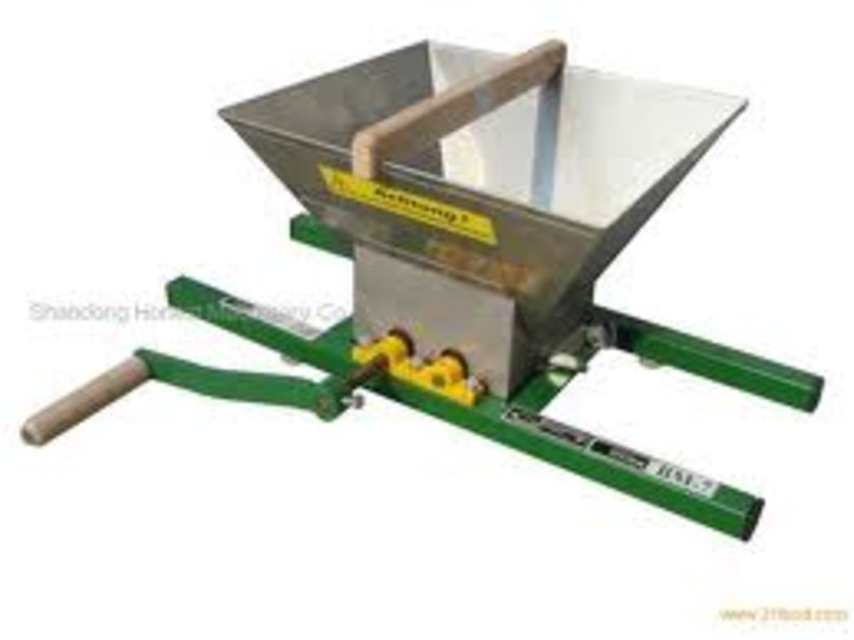 The grapes crushing machine, would be set on a vat and by turning the handle the grapes would be crushed.
