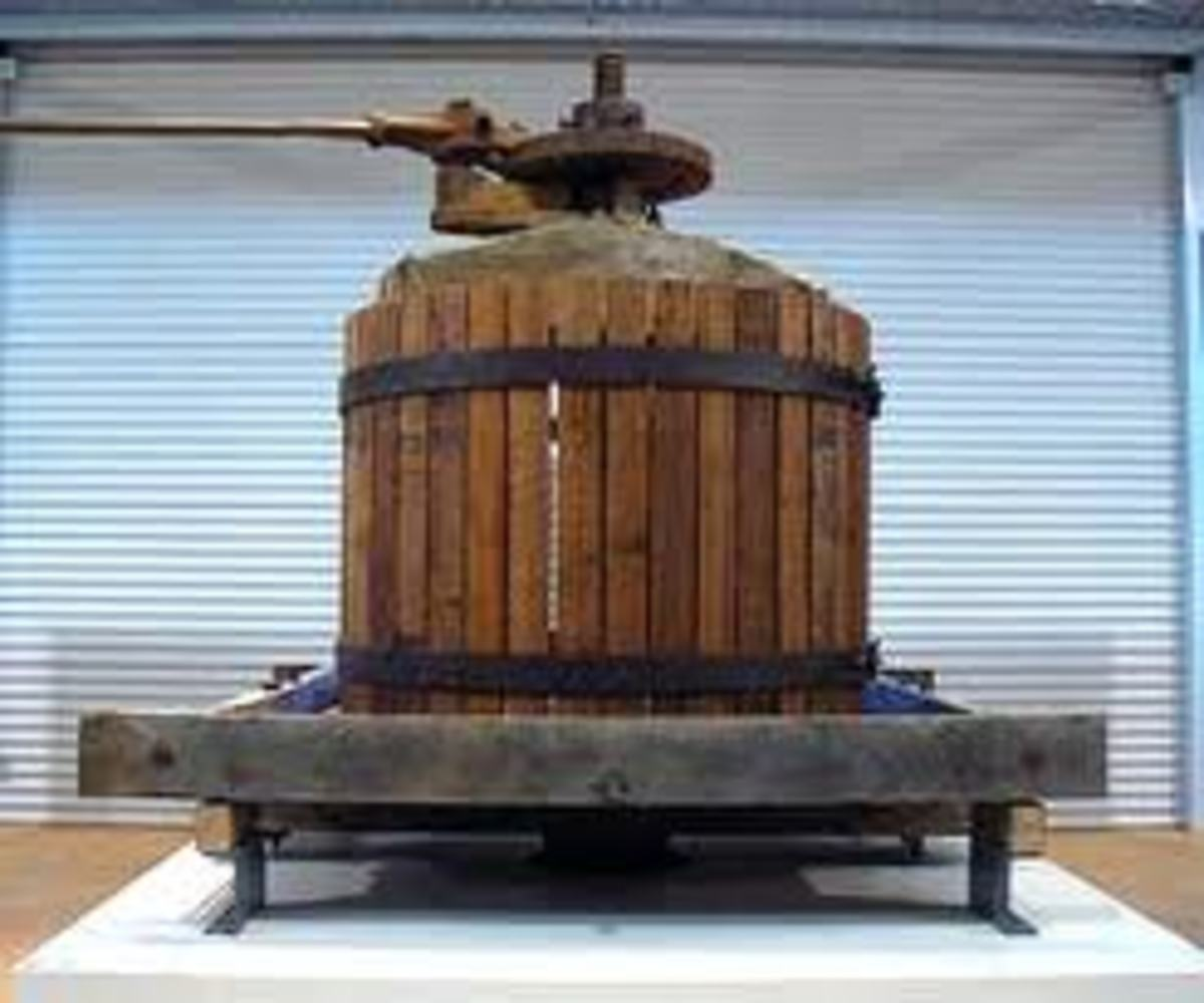 This is very much like the wine press I am talking about, except that there are no cast iron wheels to move it from place to place.