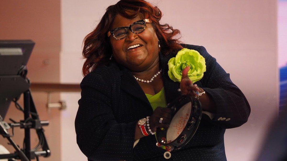 Woman using a tambourine in a church service